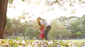 little : Mother and little daughter playing together in a park. concept happy family and slow motion. Stock Footage