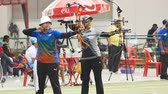 atirador : BANGKOK -MARCH 19: Unidentified archers in a row and shooting 2015 Asia Cup-World Ranking Tournament (stage II) at Hua Mak Sports Complex on March 19, 2015 in Bangkok, Thailand.