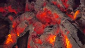 kindle : Close up of glowing flame from charcoal and firewood in kiln. abstract backgrounds Stock Footage