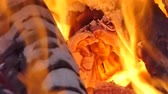 Glowing flame from charcoal and firewood in kiln.