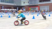 espíritos : BANGKOK - MARCH 3: Unidentified little racers with bike balance at The 1th Turnpro Cup Balance bike racing 2019 on March 3, 2019 in Bangkok, Thailand.
