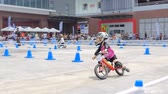 безопасный : BANGKOK - MARCH 3: Unidentified little racers with bike balance at The 1th Turnpro Cup Balance bike racing 2019 on March 3, 2019 in Bangkok, Thailand.
