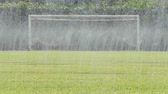 수분 : Drop water of many mini sprinkler watering in football field.