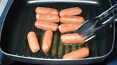 weenie : Frying sausage on a pan