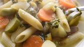 Hot minestrone with pasta and parmesan