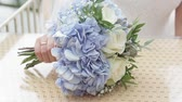 clothe : Bride puts the wedding flowers on the table