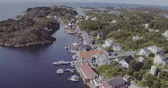 aerial accumulation of islands with houses among sea bay Stok Video