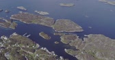 tremendous aerial view houses on fjord coast on sunny day