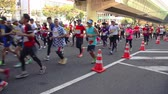 concorrentes : Runners participating in the Osaka Marathon