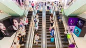 shopping : Hong Kong, China - Jun 2, 2015: 4k timelapse video of people riding an escalator in a busy shopping mall Stock Footage