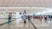 4k : Hong Kong, China - June 12, 2015: 4k hyperlapse video of travellers in the departure hall of Hong Kong International Airport.