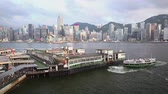 Виктория : View of Victoria Harbour and ferry terminal in Hong Kong Стоковые видеозаписи