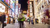 dotonbori : Osaka, Japan - Oct 28: 4k timelapse video of tourists visiting Dotonbori at night on Oct 28, 2014. Dotonbori is one of the principal tourist destinations in Osaka, Japan Stock Footage