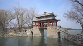Пекин : Beijing, China - Mar 19, 2018: 4k moving shot of a footbridge at Summer Palace in Beijing Стоковые видеозаписи