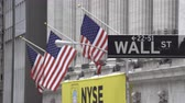jones : New York, USA - May 13, 2018: 4k video of Wall Street sign near New York Stock Exchange with flags of the United States Stock Footage