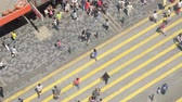 ingázó : Hong Kong, China - May 29, 2017: High angle shot of pedestrians walking in Tsim Sha Tsui, Hong Kong