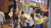 ucuz : Hong Kong, China - Jun 2, 2017: 4k video of people buying street food at food stall in Hong Kong Stok Video