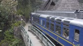 chegar : Aguas Calientes, Peru - Sep 14, 2018: Peru Rail train arriving at Machu Picchu Station in Aguas Calientes