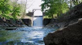 overflow pond : Old dam. Spillway on the river. The flow of water falls down Stock Footage
