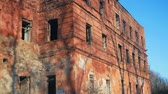 yanmış : The old burnt-out abandoned red-brick building without windows and doors. pan