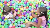 sister : Baby girls in ball pool