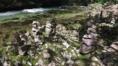 relaxation : 4K. Wild Radovna river flows in Vintgar Gorge and stone pyramids, made by people. Clean blue water and green forest. Triglav National Park, Julian Alps, Bled valley, Slovenia, Europe. Stock Footage