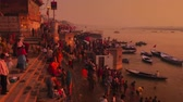 varanasi : Varanasi, India - February 06, 2015: Time lapse of devotees at Ganges river during sunrise Stock Footage