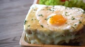 sunny side up : croque-madame toast with egg and cheese Stock Footage