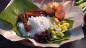 coxa : nasi lemak kukus with drumpstick malaysian local food Stock Footage