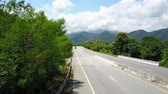 the truck drive on road with mountain view 動画素材