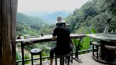 Travel woman relaxing,  enjoying scene and playing with mobile phone 動画素材