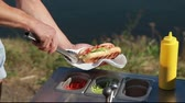 barbequed : Cooking hot dogs with fresh vegetables at a street cuisine