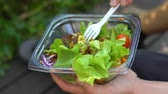 vork : Mixing Delicious Healthy Salad in Take Away Plastic Container and Then Eating it Stockvideo