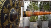 hammers : Man Hitting Large Gong at Buddhist Temple in Thailand Slow Motion