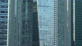 refletindo : Exterior Modern Glass Windows of Multiple Modern Office Skyscrapers in Finance District of Big City Stock Footage