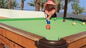 végszó : beautiful young woman plays billiards on vacation in egypt on the red sea in a hotel