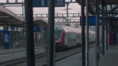 Train Station. Empty station station. Wagon for transporting bicycles. Train departure. People walk along the platform. Slow motion. Stock Footage