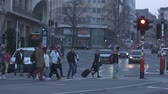 şehir merkezinde : Luxembourg March 31, 2019. People cross the road at a pedestrian crossing. Busy street of a European city. City life Evening in the big city. Daily life in the metropolis.