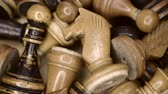 close up of vintage wooden chess pieces in box, diagonal sliding camera motion