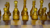 vintage wooden chess set on board, sliding camera movement