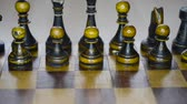 vintage wooden black chess set on board, sliding camera movement Стоковые видеозаписи