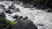 pedregulhos : wild waters of Urubamba river in Peru after heavy tropical rains, steady footage with original sound Stock Footage