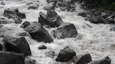 바위 : powerful waters of Urubamba river in Peru after heavy tropical rains, steady footage with original sound