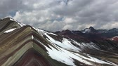 scenic panoramic footage of famous Rainbow mountains in Peru by cloudy day