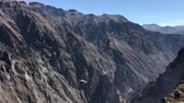 낮 : two condors flying over Colca river canyoun in Peru
