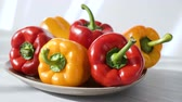bells : Colored red yellow Bell Pepper Placed on plate. white shaddow background. Healthy eating and lifestyle