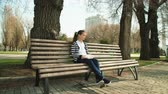 diligence : park leisure time. Young cute teen sitting bench reading book. outdoor education. Stock Footage