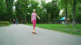 청소년 문화 : Young girl skateboarding on road in park. moves to success. teenager legs skating. leisure time 무비클립
