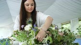 kwiaciarnia : Flowers event wedding decoration. Beautiful florist creating spring colorful bouquet arrangement. Process of preparing floral composition for celebrating party.