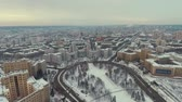 trafik : Kharkiv, Ukraine - Dec 13, 2016: Aerial of National University and Derzhprom, city covered with snow. Urban winter lifestyle